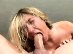 Sensual blonde girl with perky breasts offers her lover a deep blowjob