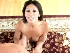 Beautiful exotic brunette does her best to jerk off a massive cock